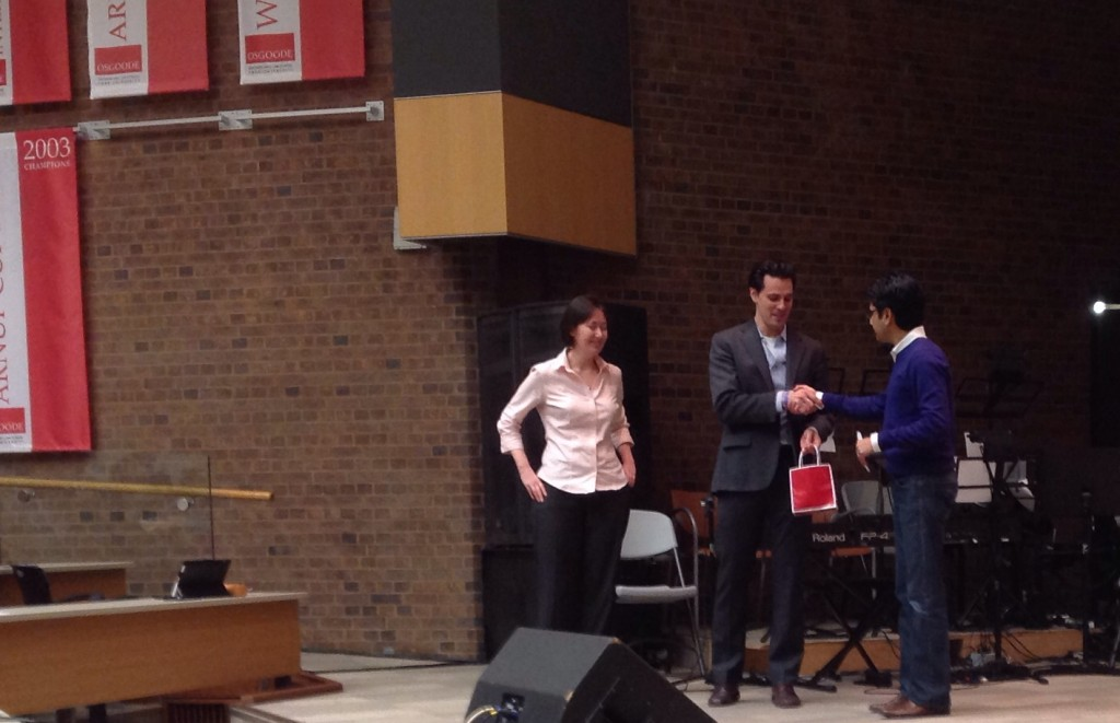 Minister Naqvi accepts a token of appreciation from L&L President Dylan McGuinty.