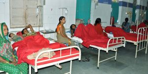 Indian women who underwent sterilization surgeries receive treatment at the CIMS hospital in Bilaspur, in the central Indian state of Chhattisgarh, Tuesday, Nov. 11, 2014. Eight Indian women have died and more than a dozen others in critical condition Tuesday after undergoing sterilization surgeries in a free government-run program to help slow the country's population growth. A total of 83 women, all poor villagers under the age of 32, had the operations Saturday in a hospital outside Bilaspur city. Each of the women had received a payment of 600 rupees, or about $10, to participate in the program, said the state's chief medical officer, Dr. S.K. Mandal. (AP Photo/Press Trust of India)